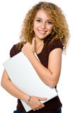 Girl Holding Laptop. A young pretty woman with laptop computer on white background stock images