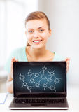 Girl holding laptop with network contacts Royalty Free Stock Image