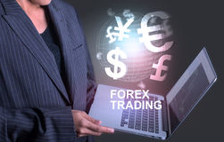 Girl  holding laptop world of currency forex trading Stock Images