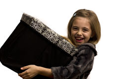 Girl holding a large gift box. On a white background Stock Image