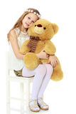 Girl holding a large Teddy bear. Royalty Free Stock Images
