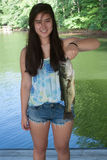 Girl Holding a Largemouth Bass Stock Photos