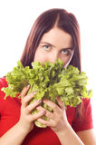 Girl is holding a leaf of salad Stock Photo