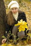 Girl holding leaves Stock Photos