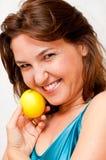 Girl holding a lemon. Smiling beautiful woman holding a lemon Stock Image