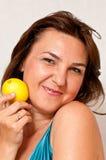 Girl holding lemon. Portrait of a smiling girl holding a fresh lemon in her hand Stock Images