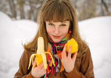Girl holding lemon and banana Royalty Free Stock Photo