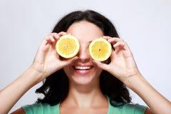 Girl holding lemon Stock Image