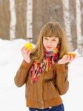 Girl holding lemon and tangerine Stock Photos