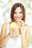 Girl holding a lemonade Stock Images