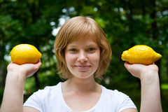 Girl holding lemons Stock Photo