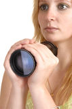 Girl holding a lens. Stock Image