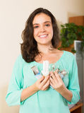 Girl holding lightbulbs Stock Photos