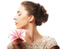 Girl holding lily flower in her hands Stock Photography