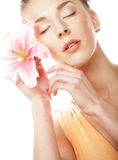 Girl holding lily flower in her hands Stock Images