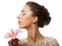 Girl holding lily flower in her hands Stock Photos