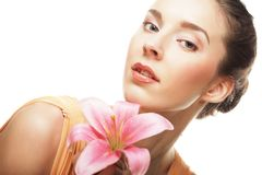 Girl holding lily flower in her hands Royalty Free Stock Photography