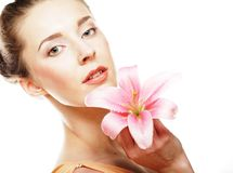 Girl holding lily flower in her hands royalty free stock images
