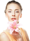 Girl holding lily flower in her hands Stock Photo