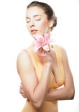 Girl holding lily flower in her hands Royalty Free Stock Image