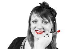Girl holding a lipstick Stock Photos