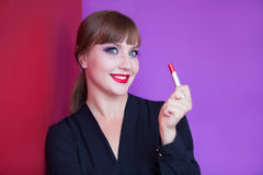 Girl holding lipstick Royalty Free Stock Photography