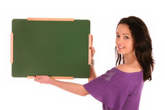 Girl holding a little school table royalty free stock image