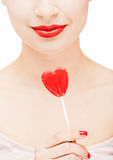 Girl holding a lollipop Stock Photography