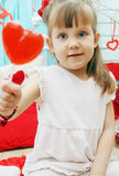 Girl holding a lollipop Royalty Free Stock Image