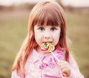 girl  holding lollipop in her hand Stock Photography