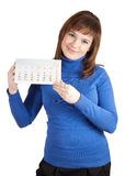 Girl holding loose-leaf calendar Stock Image