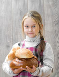 Girl holding a lot of bread Royalty Free Stock Photos