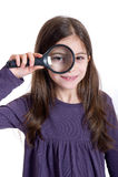 Girl holding magnifying. Smiling little Girl holding magnifying glass Stock Image