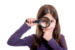 Girl holding magnifying. Glass on white background Royalty Free Stock Photo