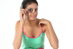 Girl holding magnifying glass Stock Photo