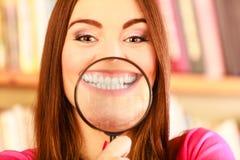 Girl holding magnifying glass Stock Photos