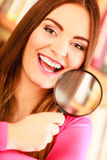 Girl holding magnifying glass Royalty Free Stock Photos