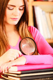 Girl holding magnifying glass Royalty Free Stock Images