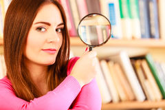 Girl holding magnifying glass Stock Photos