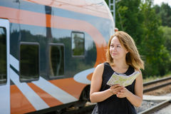 Girl holding map and watching on a train Stock Images