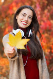 Girl holding a maple leaf Royalty Free Stock Photography