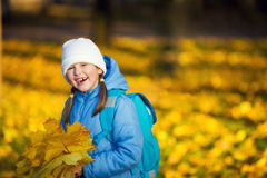 Girl holding maple leaves Stock Photography