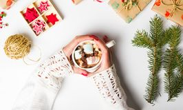 Girl holding marshmallow dessert in a cup with festive decoratio Royalty Free Stock Image