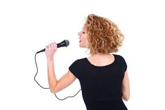Girl holding microphone Royalty Free Stock Image