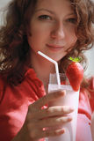 Girl holding milkshake Royalty Free Stock Images