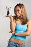 Girl Holding a Mini Man Stock Photos