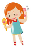 Girl holding mirror and comb Royalty Free Stock Images