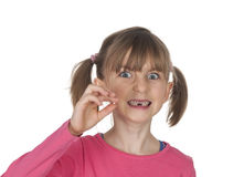 Girl holding missing tooth Stock Images
