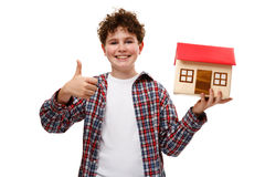 Girl holding model of house Stock Photography