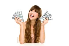 Girl holding money Stock Photos